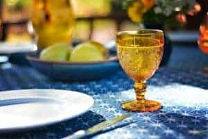 Apple and Depression Glass on the Table