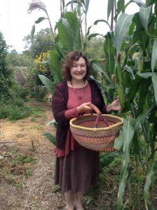 Denise picking corn in the community garden