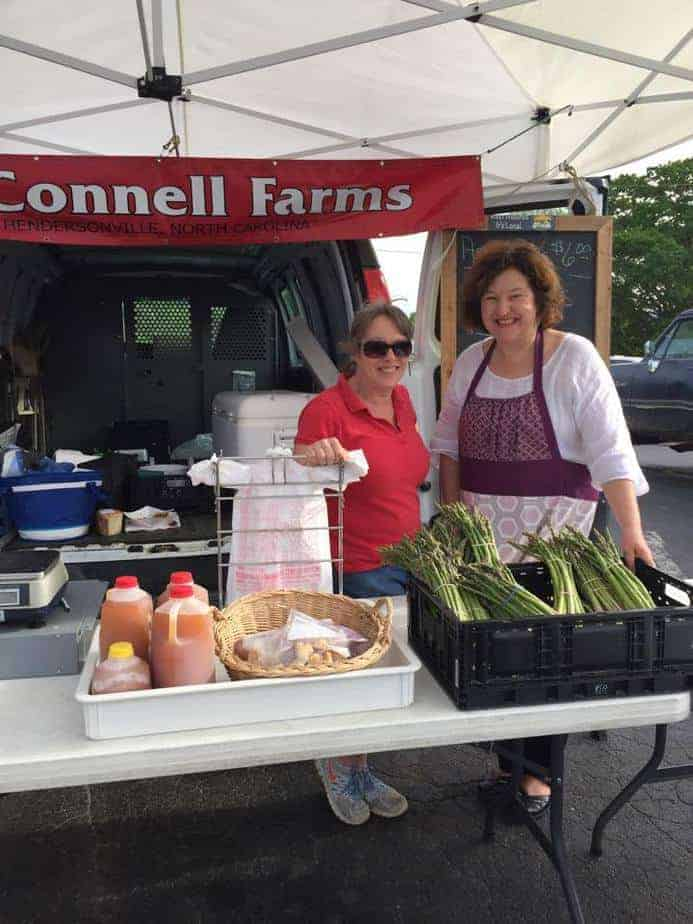 Denise at the McConnell farm table with the seasonal asparagus