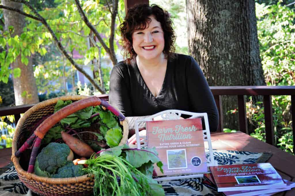 Denise and her book farm fresh nutrition ready to sign your copy
