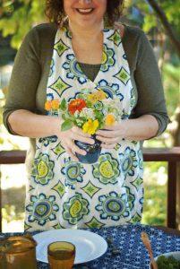 Denise in her apron in gazebo