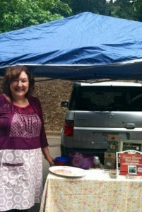 Denise hanging out at the farmers market selling her book