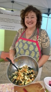 Showing off the kale salad that I made for the tailgate market