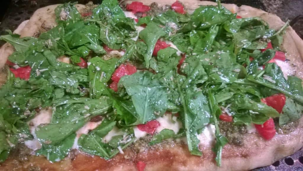 A great topping for the grilled pizza is a fresh arugula salad
