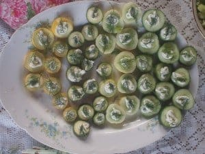 Top cucumber and summer squash with herb cream cheese and a sprig of dill for a summer tea sandwich