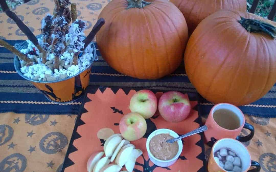 Celebrate Halloween with apples, cocoa, cider, popcorn and pretzel sticks.