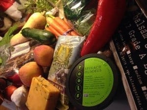 A few things in a Mother Earth produce box may include local tempeh, hummus, cheese, fruits and vegeables