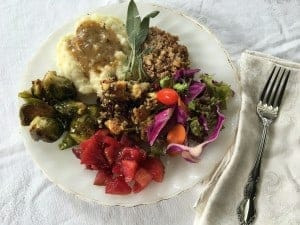 A vegan nut loaf, mashed potatoes with gravy, dressing, salad, roasted Brussels sprout and pear cranberry compote makes a delicious vegetarian Thanksgiving meal.