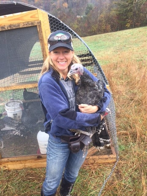 Franny on her home with heritage turkeys