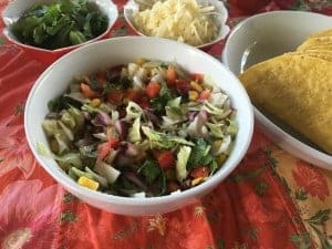This festive slaw is colorful and delcious to put in the tacos