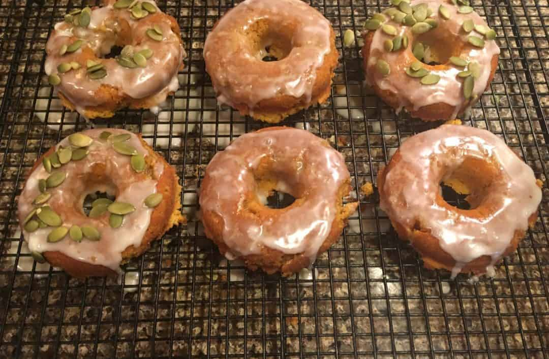 Pumpkin Donuts cooling on a bakers rack