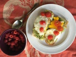 Mashed Avocado with Eggs and Tomato