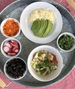 Slaw, carrots, black olives, radishes, cilantro, avocado, cheese are great taco fixings