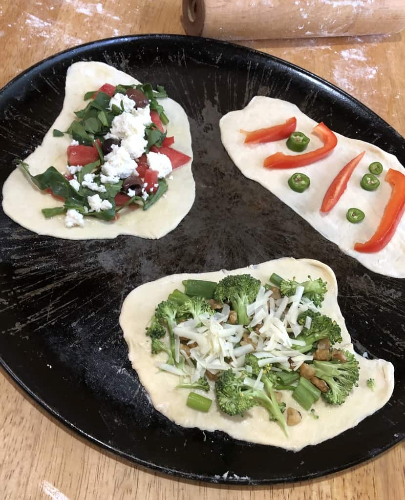 Use parchment paper to roll out these little pizzas