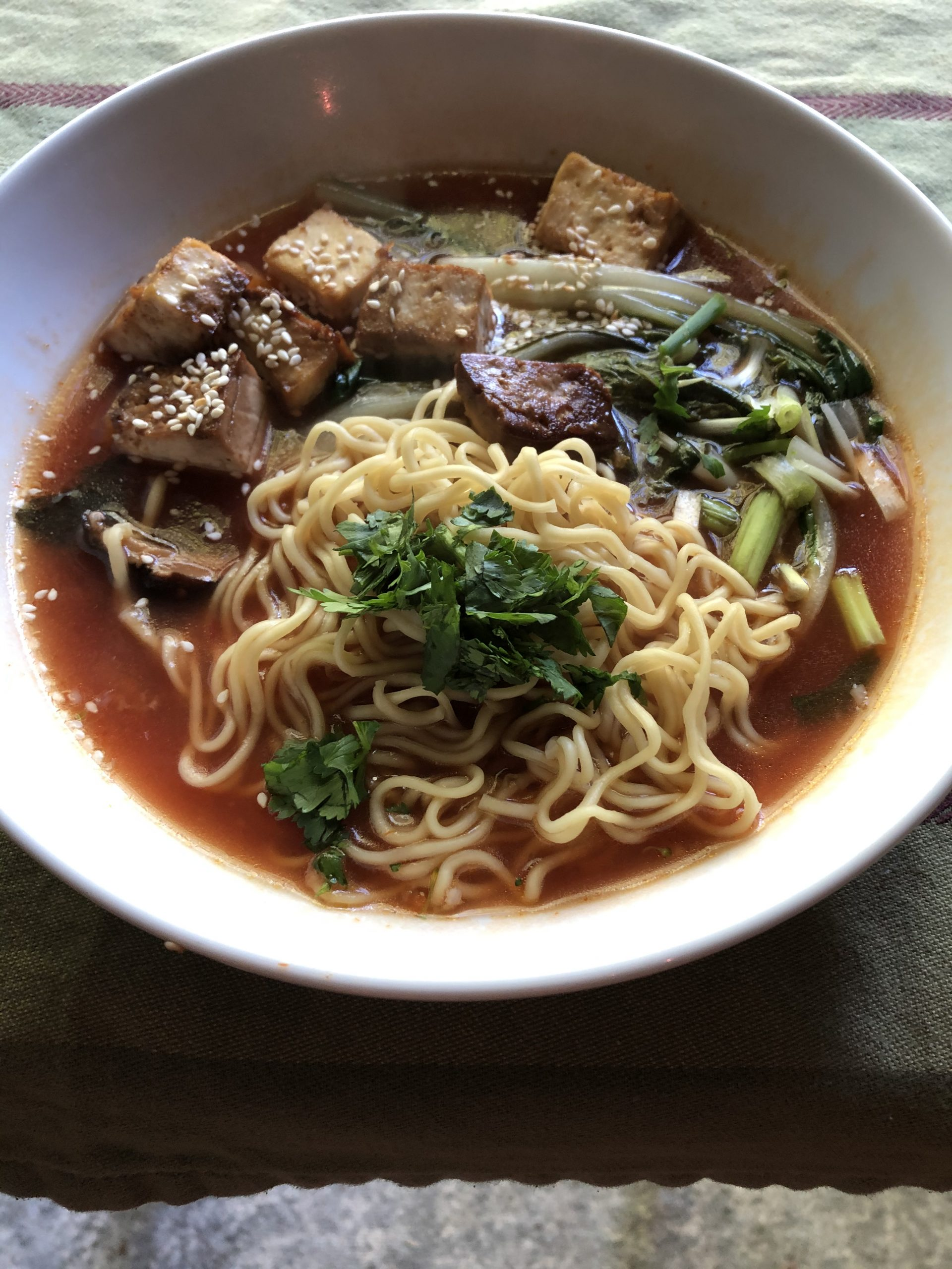 Noodles, tofu, vegetables and tomato broth ramen
